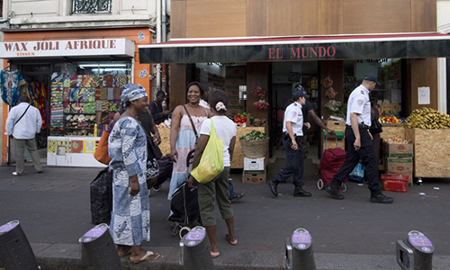 A picture taken on August 3, 2013 shows people walking in the Chateau-Rouge district in Paris. AFP PHOTO MIGUEL MEDINA / AFP PHOTO / MIGUEL MEDINA